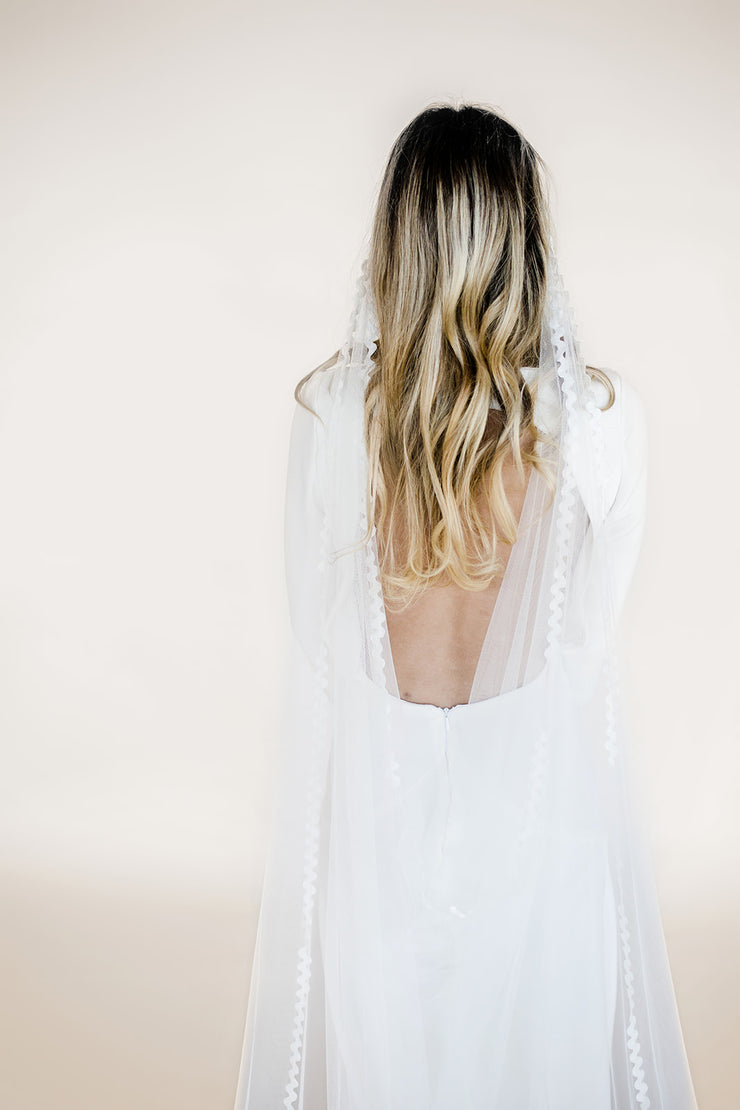 Modern wedding veil with lace trim edging and drape cowl back
