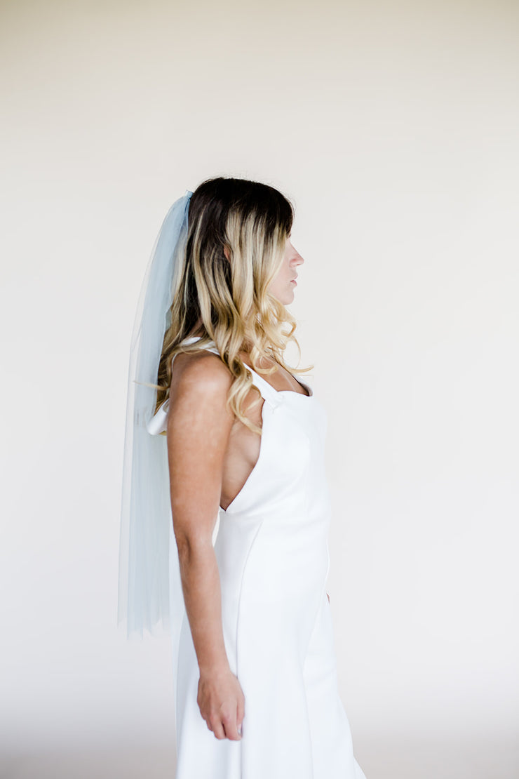 Waist length blue modern wedding veil with mother of pearl heart embellishment