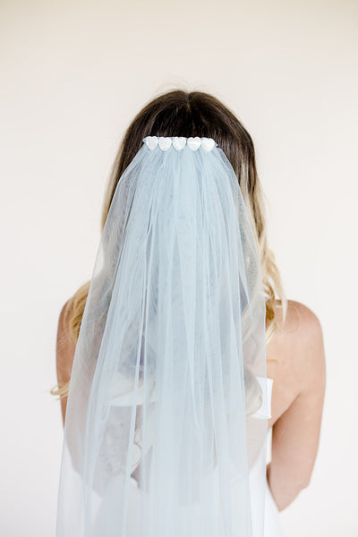 Waist length blue wedding veil with mother of pearl heart embellishment