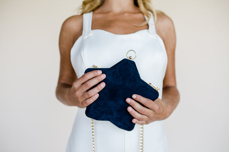 Blue suede star shaped bridal clutch bag with gold chain strap