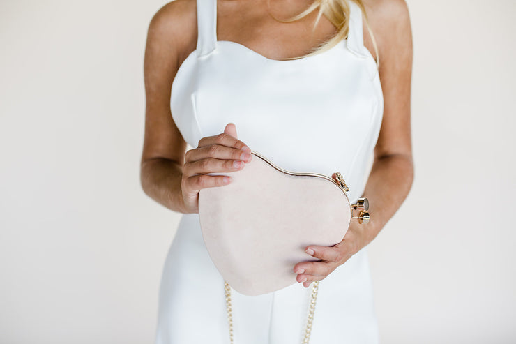 Heart shaped bridal clutch bag in blush pink suede