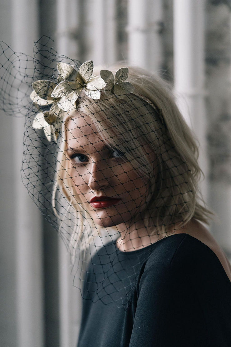 dramatic veiling birdcage and gold flower headpiece