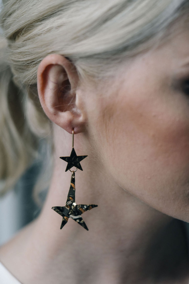 Gold star statement earrings with hammered effect
