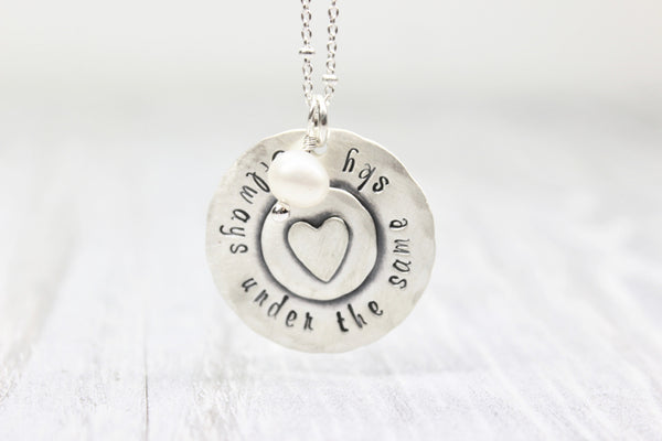 """Always under the same sky"" Handstamped Sterling Silver Keepsake Necklace"