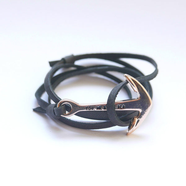 Nautical leather bracelet with a rose anchor and the band in black.