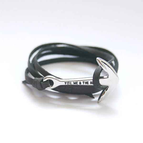 Nautical leather bracelet with a chrome anchor and the band in black.