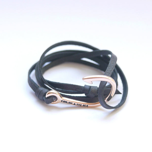 Nautical leather bracelet with a rose hook and the band in black.