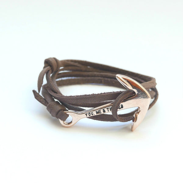 Nautical leather bracelet with a rose anchor and the band in brown.