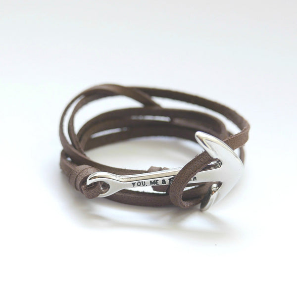 Nautical leather bracelet with a chrome anchor and the band in brown.