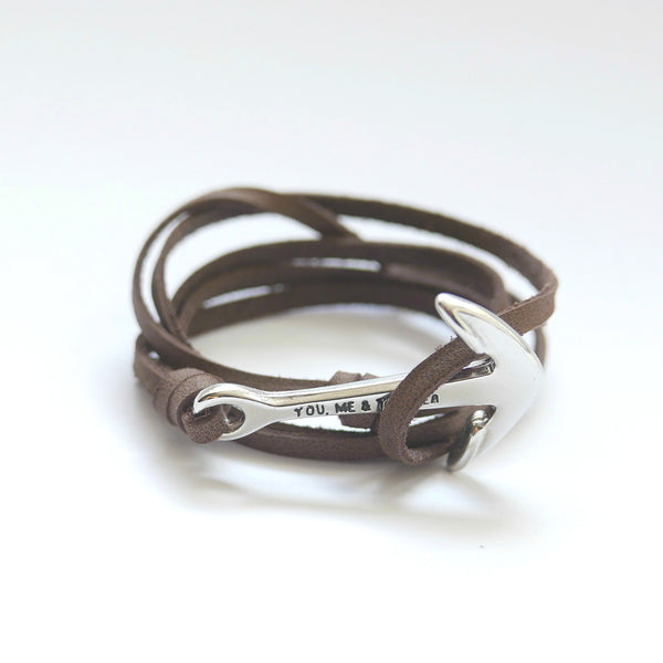 Nautical leather bracelet with a silver anchor and the band in brown.