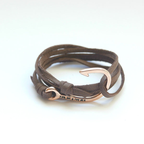 Nautical leather bracelet with a rose hook and the band in brown.