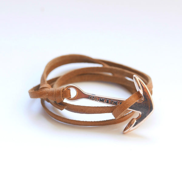 Nautical leather bracelet with a rose anchor and the band in tan.