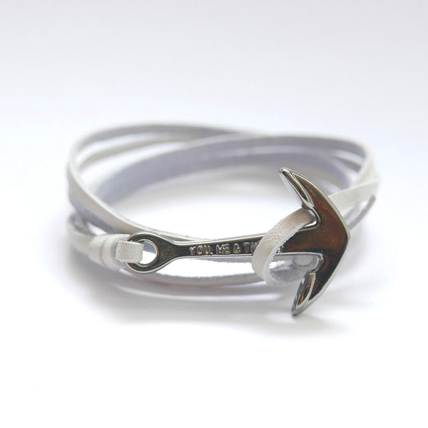 Nautical leather bracelet with a black anchor and the band in white.