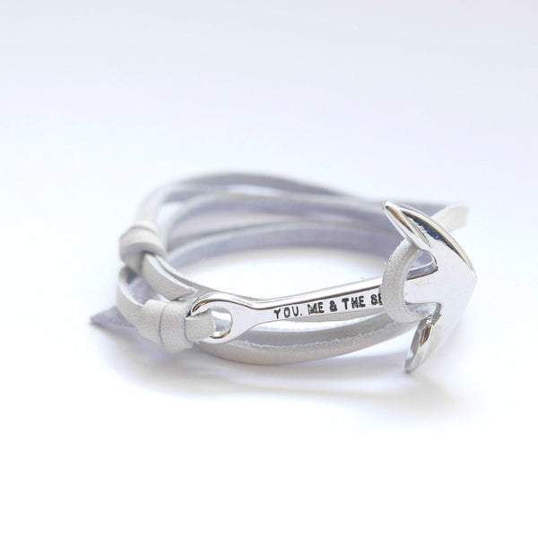 Nautical leather bracelet with a chrome anchor and the band in white.