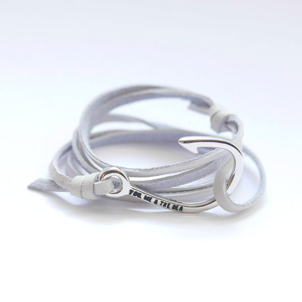 Nautical leather bracelet with a chrome hook and the band in white.