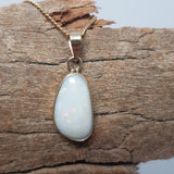 Coober Pedy solid white opal set in 9ct gold and silver 045A1B