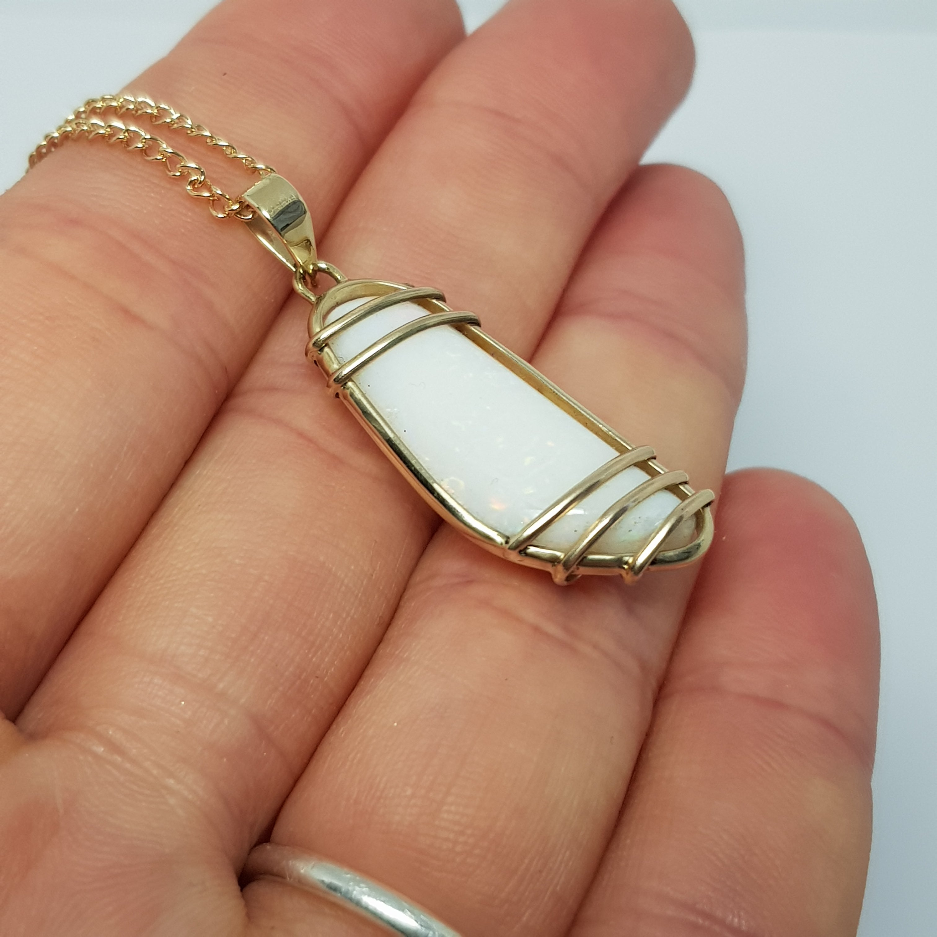 White Rainbow Opal 9k Yellow Gold Wrap Pendant 002J