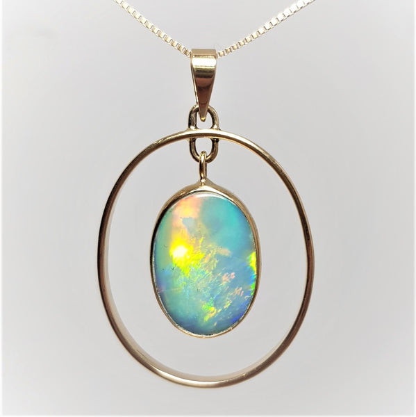 On consignment still for sale! Rare Opalised Sea Shell Pendant in 9 carat gold 066G