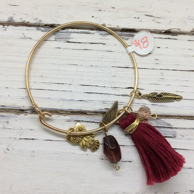 BANGLE BRACELET -   Mixed media bangle bracelet  || OOAK (ONE OF A KIND) BURGUNDY TASSEL WITH GOLD OWL, WING & FEATHER CHARMS