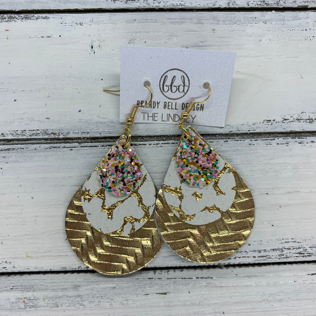 LINDSEY - Leather Earrings  ||   <BR>  BANANA SPLIT GLITTER (FAUX LEATHER), <BR> WHITE WITH GOLD ACCENTS,  <BR> METALLIC GOLD BRAIDED