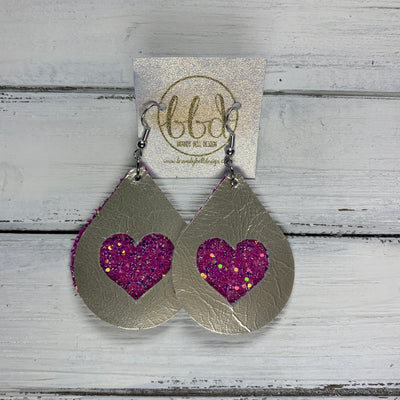 ZOEY -  <BR>  *LIMITED EDITION* CUT-OUT Earrings    ||  METALLIC CHAMPAGNE SMOOTH, SASSY PINK GLITTER HEART (FAUX LEATHER)