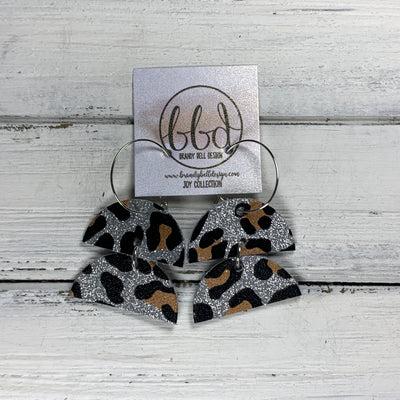 JOY - Leather Earrings  ||    <BR> SILVER GLITTER ANIMAL PRINT PATTERN ON CORK
