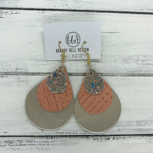 LINDSEY - Leather Earrings  ||  <BR> GLAMOUR GLITTER (NOT REAL LEATHER), <BR> SALMON PANAMA WEAVE, <BR> METALLIC CHAMPAGNE SMOOTH