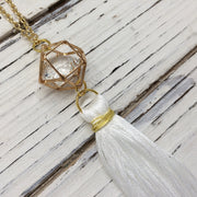 TASSEL NECKLACE - CAROLINA  || WHITE TASSEL WITH GOLD CAGE WITH ENCLOSED GEM
