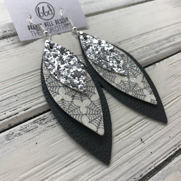 DOROTHY - Leather Earrings  ||  <BR> SILVER GLITTER (FAUX LEATHER), <BR>  GLITTER SPIDER WEBS (FAUX LEATHER),  <BR> MATTE DARK GRAY