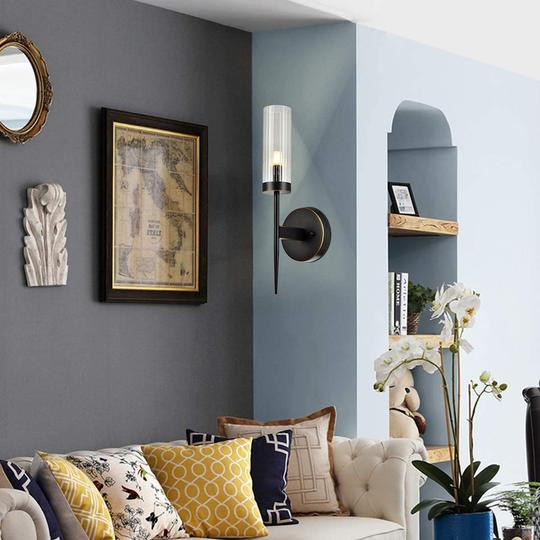 Make the most of your wall lights by painting the surface they're on a darker shade