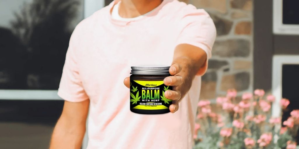 Man Holding Naked Armor's Organic Aftershave Balm