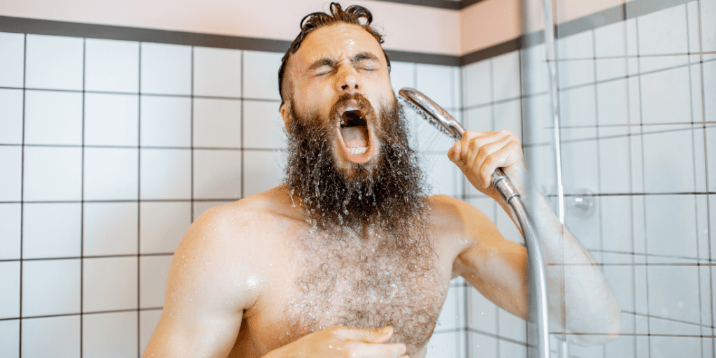 Man Showering with Cold Water