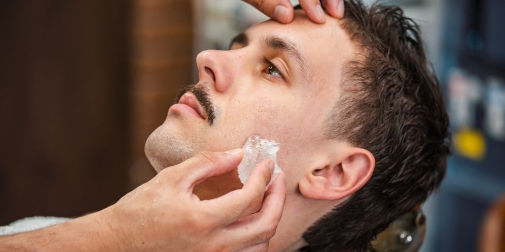 Barber Using Alum Block on a Man's Face As Aftershave