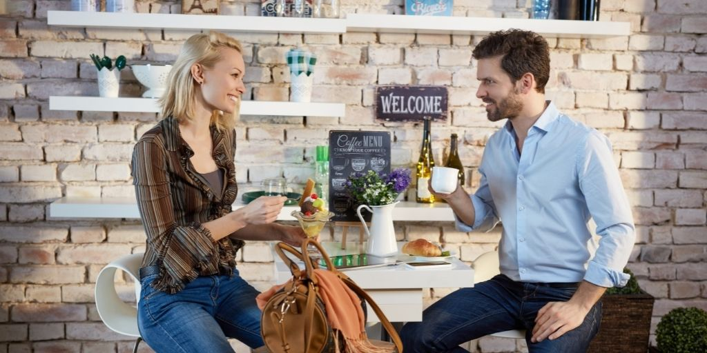Man wearing a stubble on a date with a lady