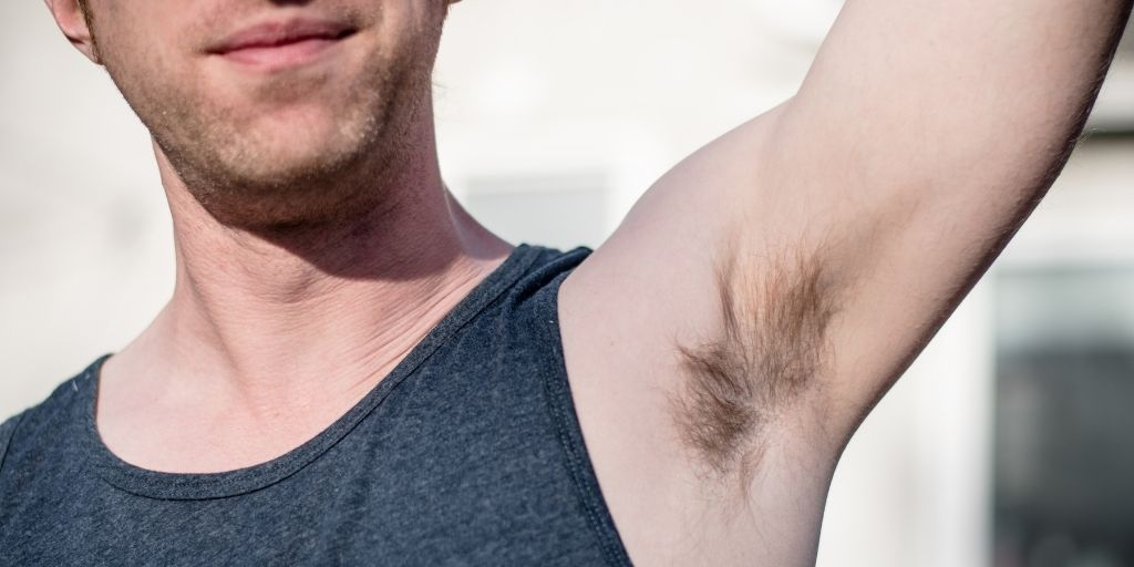 Man with hair on his armpits