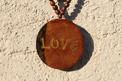 Wooden Medallion and wooden bead Necklace.  Gold Dust Highlighting the LOVE that exist in this world and in your Life.