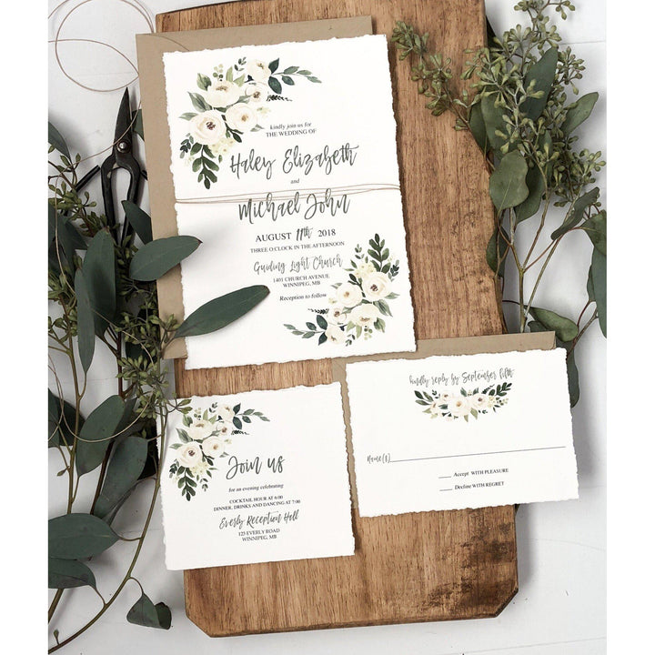 Rustic wedding invitation with soft watercolor florals
