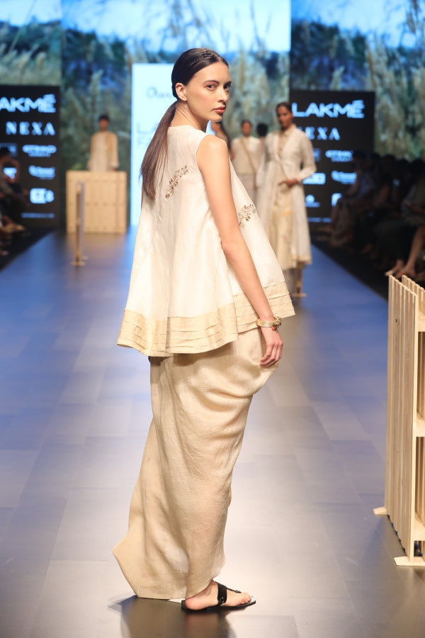 Pearl white sleeveless top and beige silk Dhoti pants