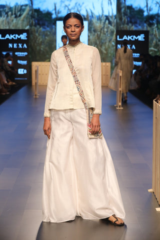 Ecru white Banarasi cotton pants team with a organza mul top and chanderi jacket