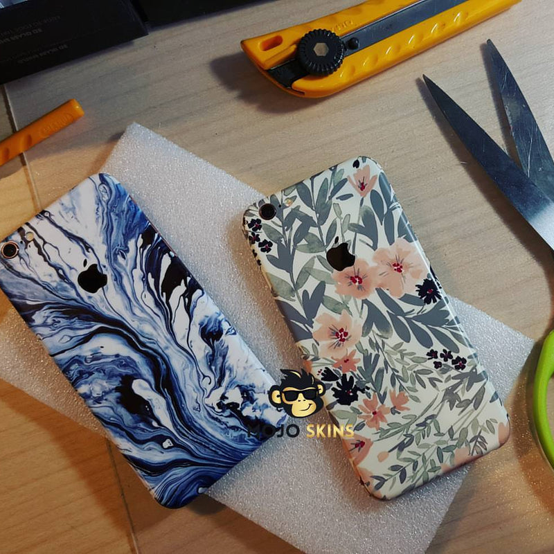 Mojo skins - flower and running blue paint phone skins