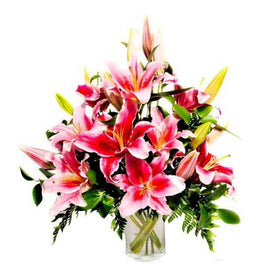 Table Arrangement Of Pink Lilies And Greens