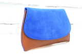 [Electric Bluebonnet Suede/Saddle Tan] Pommel Clutch angled view