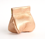 Metallic [Rose Gold] leather Bauble Bag with retro squeeze frame closure.