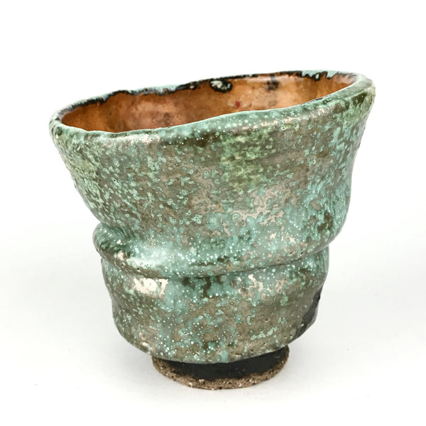 Multiple-fired stone cup with metallic green glaze