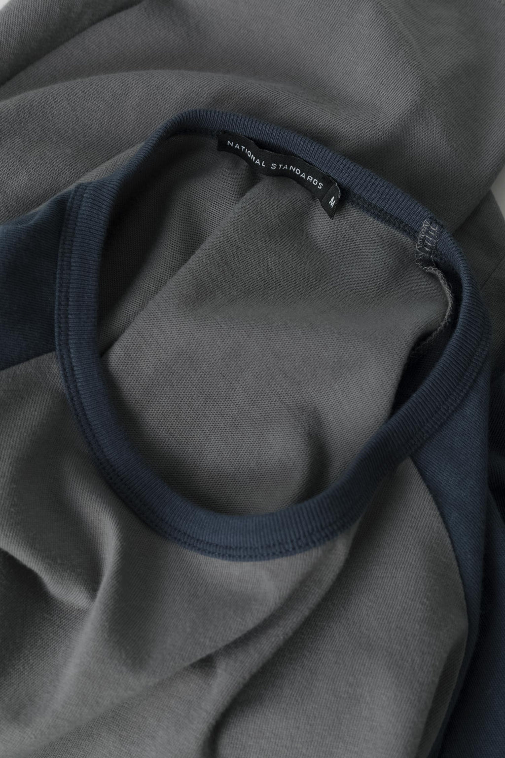 Fabric detail of the ready-to-wear Spun Jersey Raglan in Grey / Blue 007
