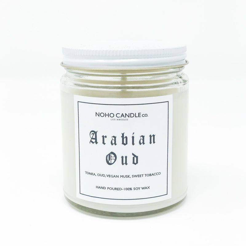 A 9 oz. glass jar containing 8 ounces of Arabian Oud candle.  The lid is white and the candle is, too.