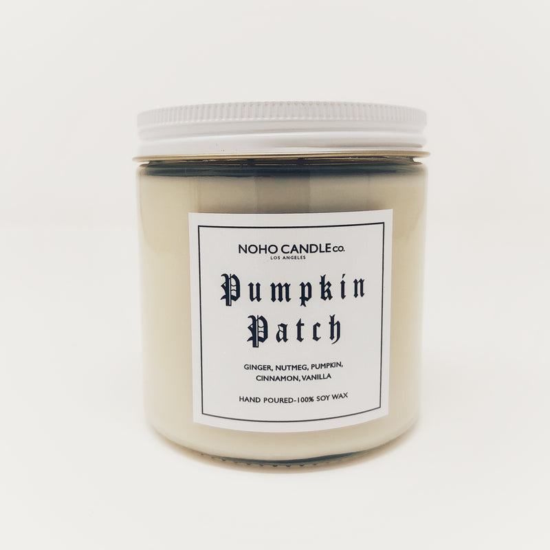 The 16-oz jar for the pumpkin patch candle.  It comes with a white lid and the color scheme is mostly white with some hints of black.  The candle comes in a glass jar.
