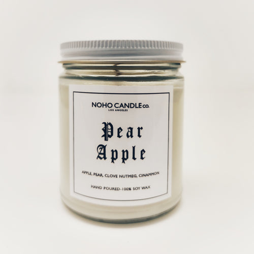 A white Pear Apple candle in a clear glass 9oz jar with a white lid.  The amount of candle inside the jar is 8 fluid ounces.