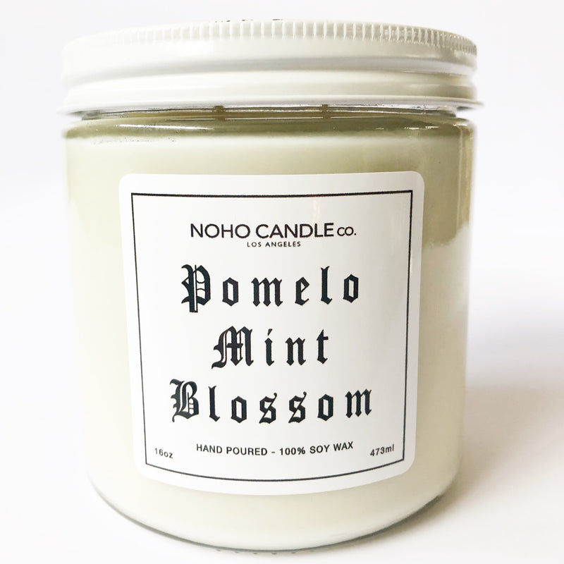 A 16-oz jar of Pomelo Mint Blossom candle with a white screw-on lid.