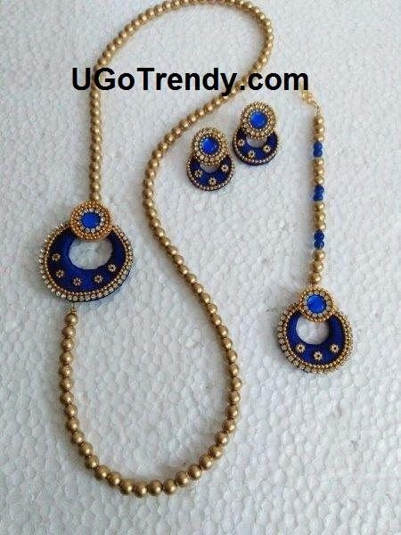 Golden tone Bead Necklace with Chandbali side pendant, matching Chandbali earring and maang tikka decorated with Rhinestones and metal beads